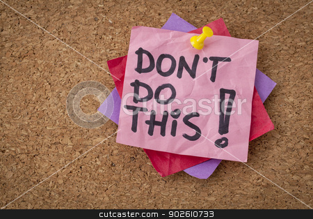 do not do this advice stock photo, do not do this  advice or warning - handwriting on pink sticky note by Marek Uliasz