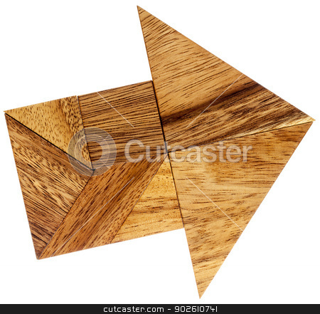 tangram arrow stock photo, abstract picture of an arrow built from seven tangram wooden pieces, a traditional Chinese puzzle game by Marek Uliasz
