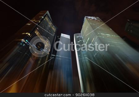Night skyscrapers stretching into the sky stock photo, Night skyscrapers stretching into the dark sky by Alexey Romanov