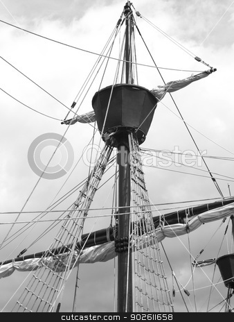 Old style sail boat stock photo, Historical style sail boat on a classic tall ship black and white vertical by ABBPhoto