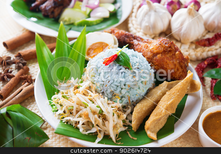Nasi kerabu stock photo, Nasi kerabu or nasi ulam, popular Malaysian Malay rice dish. Blue color of rice resulting from the petals of butterfly-pea flowers. Traditional Malaysia food, Asian cuisine. by szefei