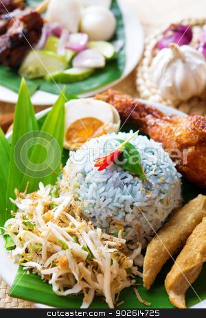 nasi ulam stock photo, Nasi kerabu or nasi ulam, popular Malaysian Malay rice dish. Traditional east coast blue rice. Famous in states such as Terengganu or Kelantan . Malaysia food, Asian cuisine. by szefei