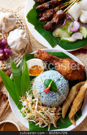 Malay rice dish stock photo, Nasi kerabu, popular Malaysian Malay rice dish. Traditional east coast blue rice. Famous in states such as Terengganu or Kelantan . Malaysia food, Asian cuisine. by szefei