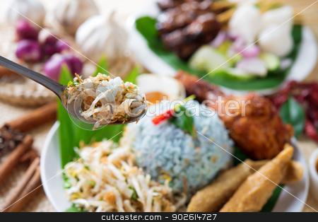 Malaysia food stock photo, Nasi kerabu, famous Malaysian Malay rice dish. Traditional east coast blue rice. Popular in states such as Terengganu or Kelantan . Malaysia food, Asian cuisine. by szefei