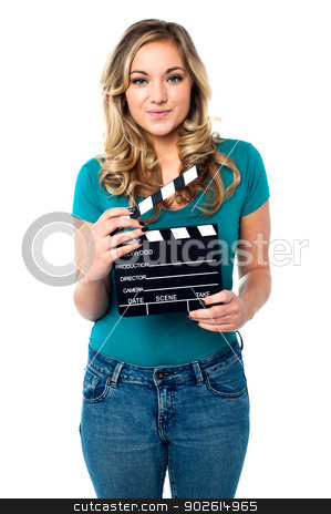 Its showtime. Ready for next shot? stock photo, Isolated modern young woman posing with clapperboard by Ishay Botbol