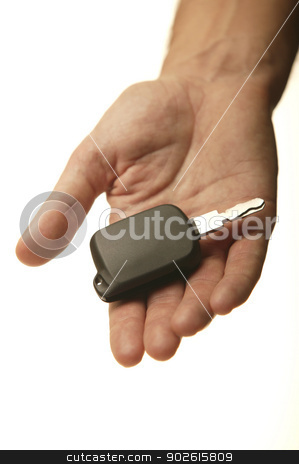 Car key on human hand  stock photo, Car key on human hand easy isolated on white vertical by ABBPhoto