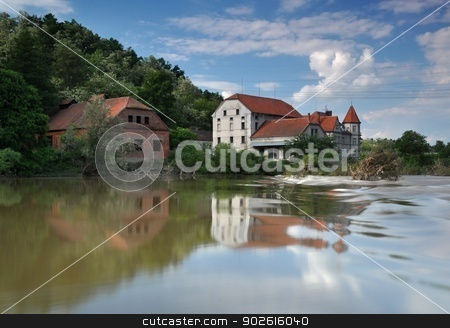 An old house on the river stock photo, Old house on the banks of the swollen river by Ondrej Vladyka