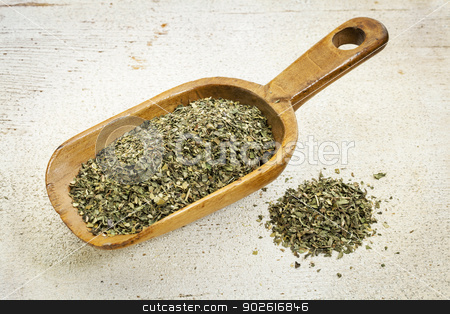 scoop of peppermint tea stock photo, organic peppermint herbal tea - rustic wooden scoop and a pile on rough white painted barn wood by Marek Uliasz