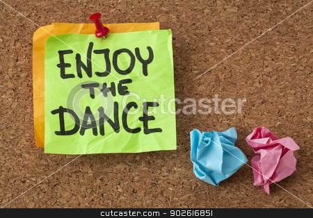 enjoy the dance stock photo, enjoy the dance - a motivational reminder on a sticky note by Marek Uliasz