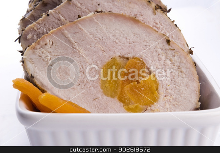 Roasted pork loin with dried apricots stock photo, Roasted pork loin with dried apricots by sierpniowka