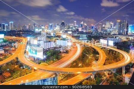 Bangkok downtown Skyline at night stock photo, Bangkok Highway at Dusk with skyline in Thailand by Vichaya Kiatying-Angsulee