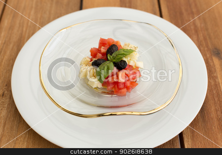 Mozzarella and tomatoes tartar stock photo, Mozzarella and tomatoes tartar in glass plate on a wooden table. by doupix