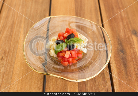 Caprese tartar stock photo, Caprese tartar in soup glass plate on a wooden table. by doupix