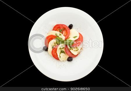 Fresh tomatoes, mozzarella salad stock photo, Fresh tomatoes, mozzarella salad in white plate on a black background. by doupix