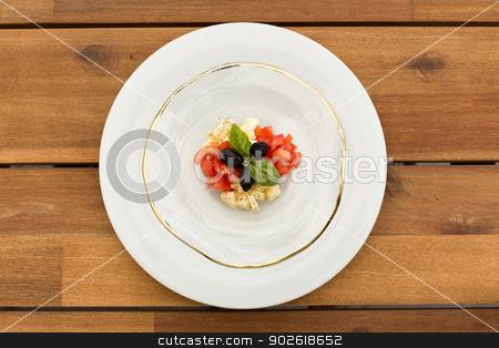 Fresh caprese tartar stock photo, Fresh caprese tartar in glass plate on a wooden table. by doupix