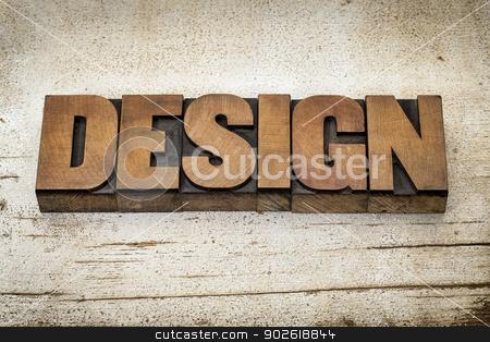 design word in wood type stock photo, design word in vintage letterpress wood type on a grunge painted barn wood background by Marek Uliasz