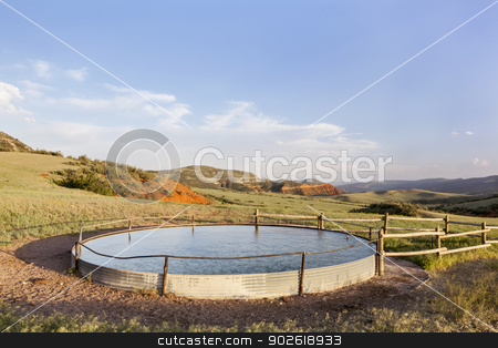 cattle water tank stock photo, cattle water tank in Colorado mountain ranch - Red Mountain Open Space near Fort Collins by Marek Uliasz