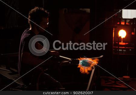 Hot Flame Shaping Glass Object stock photo, Hot flame from blowtorch shaping a glass object by Scott Griessel