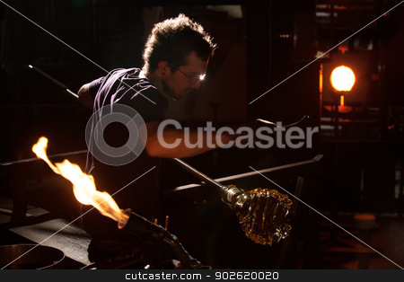 Glass Worker Near Blast Furnace stock photo, Glass worker near blast furnace and blowtorch by Scott Griessel