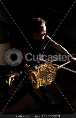 Finishing Glass Art Jar stock photo, Man finishing fine art glass jar with rod  by Scott Griessel