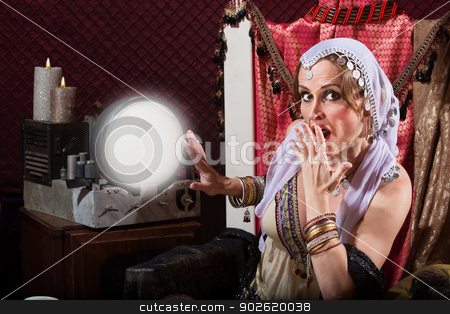 Startled Fortune Teller stock photo, Startled sexy female fortune teller in headscarf by Scott Griessel
