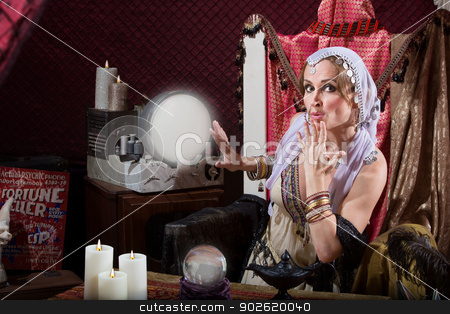 Beautiful Fortune Teller stock photo, Beautiful fortune teller with hand over her mouth by Scott Griessel