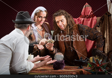 Fortune Teller Scam stock photo, Helpless customer with fortune teller holding his money by Scott Griessel
