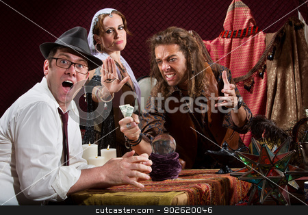 Insulted Fortune Teller stock photo, Insulted fortune teller with surprised customer indoors by Scott Griessel
