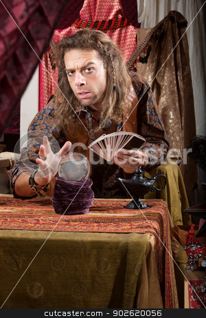 Stoic Soothsayer stock photo, Stoic handsome gypsy man with crystal ball by Scott Griessel