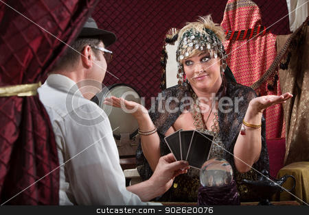 Gullible Fortune Teller stock photo, Customer showing happy tarot cards to fortune teller by Scott Griessel