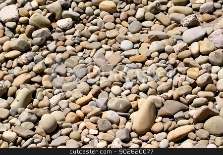 Pebbles stock photo, River rock pebbles with shades of different gray. by Henrik Lehnerer