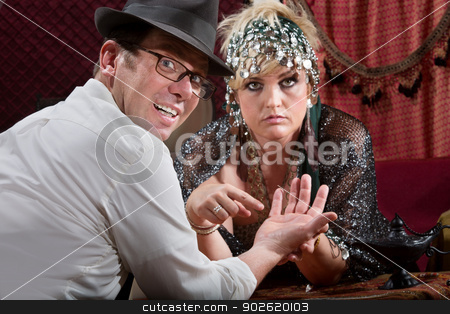 Scared Man with Evil Eye stock photo, Scared man with fortune teller and evil eye symbol in palm by Scott Griessel