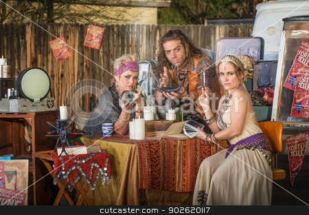 Gypsies with Lamp and Crystal Ball stock photo, Three serious gypsy fortune tellers with outdoor kiosk by Scott Griessel
