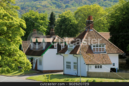 Houses in English village stock photo, White houses in English village with forest in background, Scalby, North Yorkshire, England. by Martin Crowdy