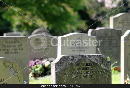 Old graves in cemetery stock photo, Closeup of old Victorian graves in cemetery, England. by Martin Crowdy