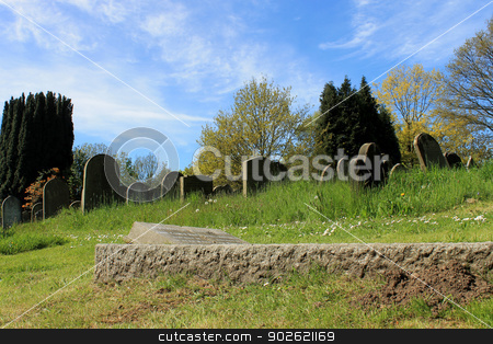 Old graves in cemetery stock photo, Scenic view of old graves in cemetery, summer scene. by Martin Crowdy