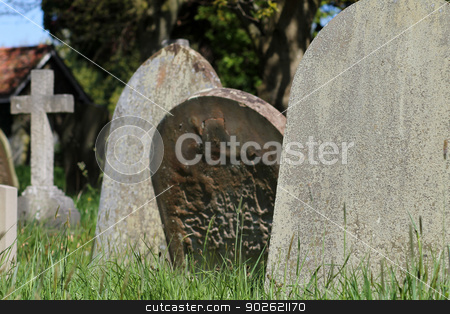 Old graves in English cemetery stock photo, Closeup of old graves in English cemetery by Martin Crowdy