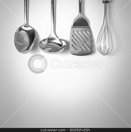 Kitchen tools background stock photo, Set of kitchen tools hanged up in the wall by Pedro Campos