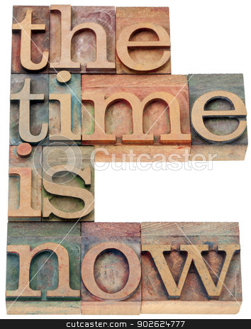 the time is now in wood type stock photo, the time is now - motivational concept - isolated text in letterpress wood type by Marek Uliasz