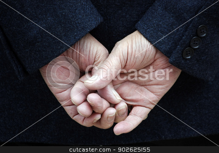crossed fingers stock photo, Dark blue jacket and two hands with crossed fingers. by Mauro Rodrigues