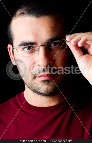 male man with glasses stock photo, Close detail view of a young male man with glasses isolated on a black background. by Mauro Rodrigues