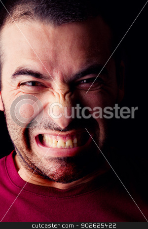 furious male man stock photo, Close detail view of a furious young male man isolated on a black background. by Mauro Rodrigues