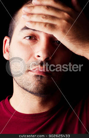 male man with a fever stock photo, Close detail view of a young male man with a fever isolated on a black background. by Mauro Rodrigues