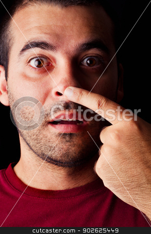 funny male man stock photo, Close detail view of a funny young male man with finger on nose isolated on a black background. by Mauro Rodrigues