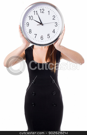 Meeting time will be declared in five minutes stock photo, Young woman hiding her face with a wall clock by Ishay Botbol