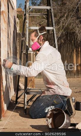 Adult Graffiti Artist stock photo, Adult graffiti artist working on mural outdoors by Scott Griessel