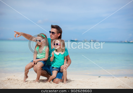 Happy father with his two daughters sitting on tropical beach vacation stock photo, Happy father with his two daughters sitting on tropical beach vacation by Dmitry Travnikov
