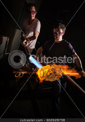 Men Forming Glass Art stock photo, Men working with flaming blowtorch on glass art piece by Scott Griessel