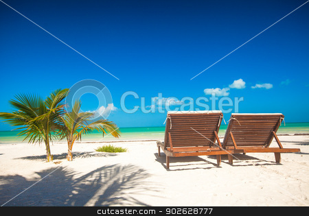 Two beach loungers on the exotic resort on white sand beach stock photo, Two beach loungers on the exotic resort on white sand beach by Dmitry Travnikov