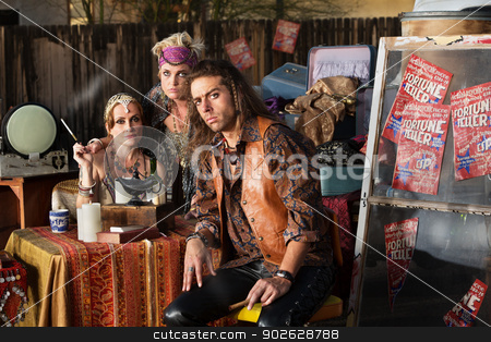 Trio of Fortune Tellers stock photo, Three serious fortune tellers sitting outside with table by Scott Griessel